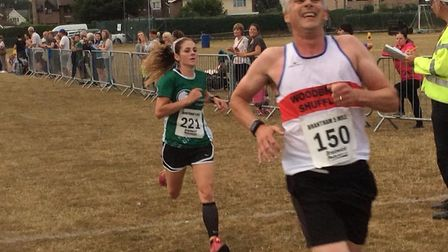 Emma Mortimer (No. 221) on her way to victory in the ladies' race at the Brantham five-miler. Woodbr