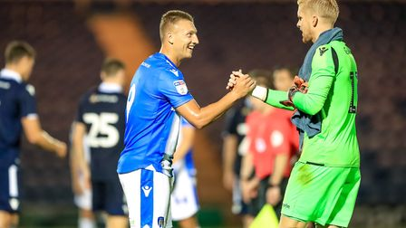 Summer recruit Luke Norris shakes hands with Millwall keeper Ben Amos at the end of the pre-season f