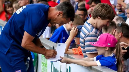 Town manager Paul Hurst signing autographs last week. Picture: STEVE WALLER