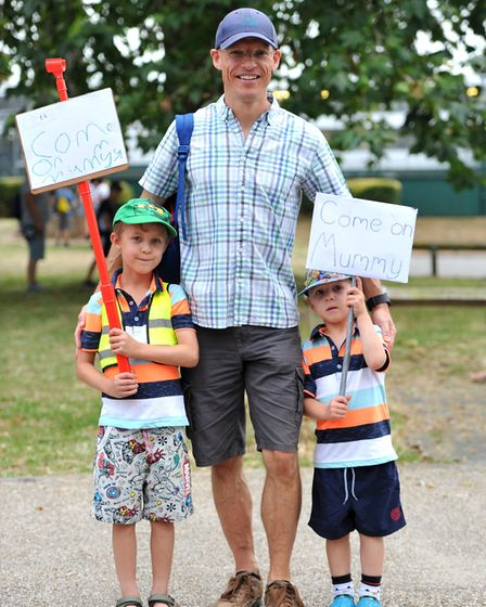 Lee Eastall with Austin and Isaac cheering on the runners Picture: SARAH LUCY BROWN