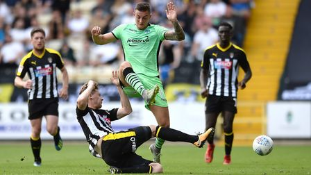 Brennan Dickenson is challenged by Elliott Hewitt during Saturday's 0-0 draw at Notts County. Pictur