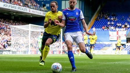 Elliott Bennett and Cole Skuse go shoulder to shoulder ahead of the Ipswich man ending up in the pho