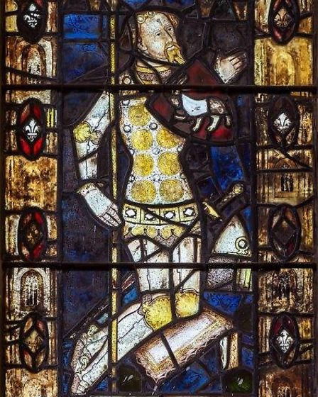 The stained glass window of Sir William de Berdewell at St Peter and St Paul's CHurch in Bardwell, w