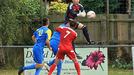 Felixstowes newest recruit, Joe Potter, climbs highest to see off the danger against Downham. Pictur
