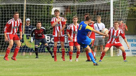 Downham's Isaac Bloodworth sees his free kick deflected by the Felixstowe wall. Picture: STAN BASTON