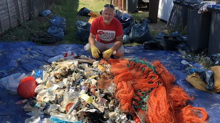 Jason Alexander with some of the rubbish he collected along the Marathon Beach Clean Picture: RUBBIS