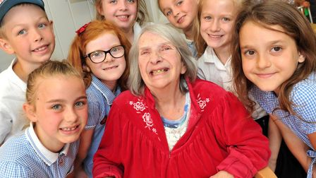 Cleves Place resident Jean Bishop with children from Couplas Primary School Picture: LUCY TAYLOR PHO