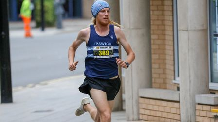 Jack Millar, out on his own, and on his way to victory at the Ipswich Twilight 10K. Picture:SIMON HO