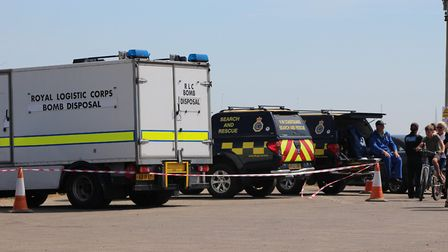 Bomb disposal and coastguards at the scene of the incident involving suspected ordnance at Orford Ne