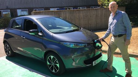 West Suffolk councillor Lance Stanbury charging up a Renault Zoe Picture; SALLY EASTON