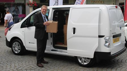 West Suffolk councillor Alaric Pugh with a Nissan ENV200 demonstrating how EVs are also a realistic