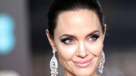 Angelina Jolie doesn't always get on with her father, actor Jon Voight. Picture: PA Wire/Yui Mok