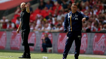 Paul Hurst (right) saw his Shrewsbury Town side lose to Paul Warne's (left) Rotherham United outfit