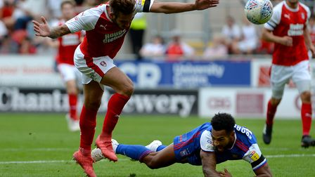 Jordan Roberts goes to ground in the Rotherham penalty area after running through with defender Joe