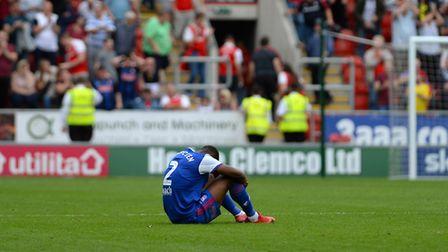 Janoi Donacien sits on the pitch disappointed at Rotherham Picture Pagepix