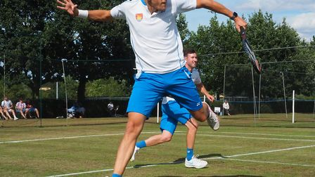 Jez Cowley plays a volley as Matt Hough watches on. The duo won the Suffolk doubles title at Framlin