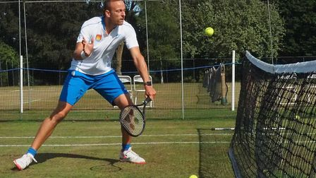 Jez Cowley cushions a volley on his way to the doubles title at Framlingham. Picture: ANTHONY WILLOU