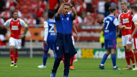 Ipswich Town manager Paul Hurst applauds the travelling fans at Rotherham. Photo: Pagepix