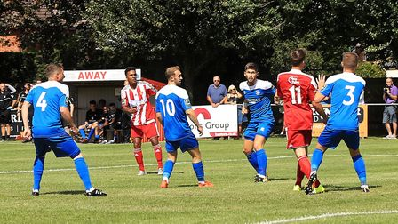 Rhys Henry (second left) clears the Bury Town back line to open the scoring for the Seasiders. Pictu