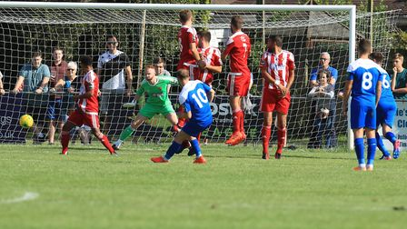 Bury's Ryan Horne slots his free kick wide of the Seasiders' wall to make it 3-1. Picture: STAN BAST
