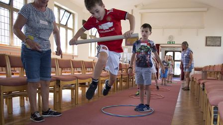 Callum and Conor taking part in their group challenge at the Psalm Tree Island holiday club in Felix