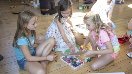 Olivia, Isabelle and Adela creating a junk model Picture: ROBIN AND MARY PATTINSON