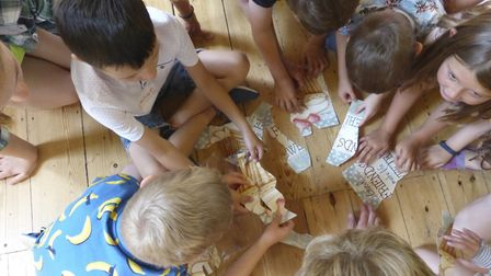 The Terrific Turtles putting together their jigsaw as part of the story at the holiday club Picture: