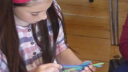 Sophie making a turtle at the Seaton Road Methodist holiday club in Felixstowe Picture: ROBIN AND MA