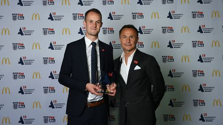 George Byrne (left) receives his Match Official of the Year award from former Chelsea and England mi