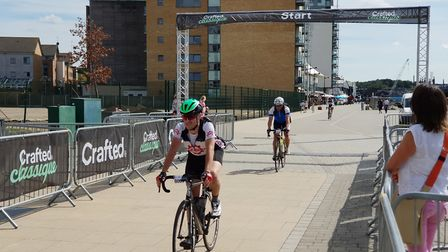 Cyclists cross the finishing line outside the Cult Cafe in Ipswich after a scenic ride through the c