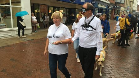 Mr Martin was guided through the town centre by Helen Sismore, from Guide Dogs UK Picture: IPSWICH B