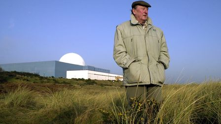 Charles Barnett, leader of the Shut Down Sizewell campaign, on the beach in front of Sizewell B in 2