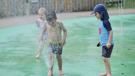Children enjoy the water jets at Holywells Park in Ipswich Picture: SARAH LUCY BROWN