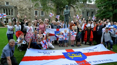 """The We Love Bury St Edmunds group holding a """"Photobomb the King"""" event by the statue of St Edmund la"""
