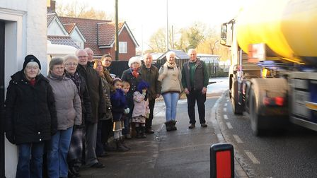 Campaigners for the four villages bypass, pictured on the bend at Farnham Picture; SARAH LUCY BROWN