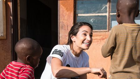 The singer also visited a school and sang and danced with the children Picture: DSWF