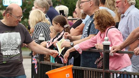 Crowds enjoy the procession at Sudbury Carnival Picture: ANDY HOWES