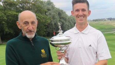 David Southgate receives the Coronation Cup from Felixstowe Ferry captain Graham Popple. Picture: TO