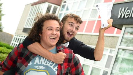 Tristan Sayers (right) and friend Connor Robinson. Tristan achieved two Distinction*s and one Distin