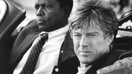 Sidney Poitier and Robert Redford in the comedy caper movie Sneakers Photo Universal