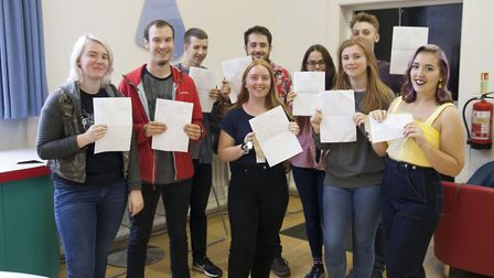 Students celebrating their A-level results at Mildenhall College Academy.