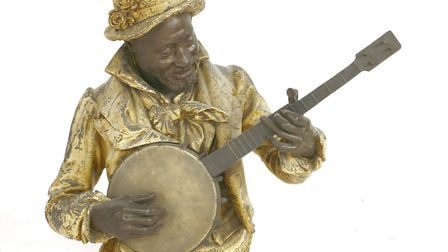 A gold-painted spelter figure of a musician. Picture: Sworders