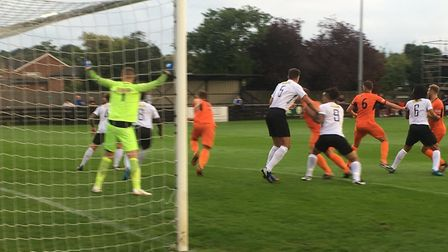 Goalmouth action from Leiston's (orange shirts) 5-2 win at Royston Town on Tuesday night. Picture: C