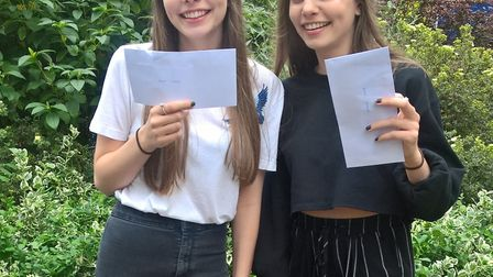 Twins Ella and Amy Marr with their identical A-level results Picture: Colchester Sixth Form College