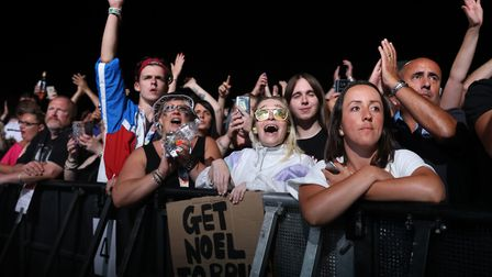 Fans watch Liam Gallagher on stage Picture: Isabel Infantes/PA Wire