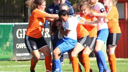 An Enfield Town player was sent off for putting Ipswich Town's Mollie DeBell in a headlock in a braw