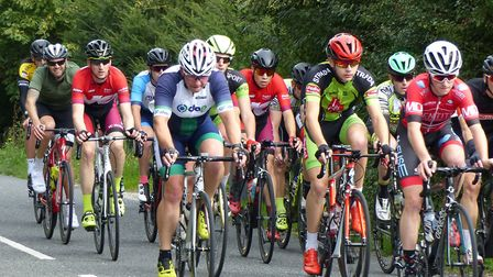 Colchester rider Nick Flexman heads the bunch in the Orwell Velo Road Race with Jake Towler from Bec
