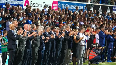 Former teammates during the minutes applause for Kevin Beattie ahead of the match. Picture: STEVE