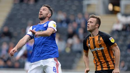 Cole Skuse under pressure from Hull's Todd Kane Picture Pagepix