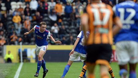 Matthew Pennington heads the ball forwards at Hull Picture Pagepix